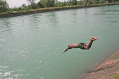 Diving in mid air. Cooling off with a river dive on a hot day Stock Images
