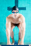 Diving off the starting block Royalty Free Stock Image