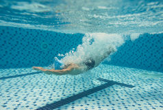 Diving in the pool. Image of a man diving in the swimming pool Royalty Free Stock Photo
