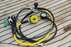 Diving regulators and mouthpiece on boat deck. Closeup royalty free stock image