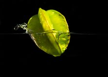 Diving Star. A star fruit graceful dives into the water with hardly a splash stock photo