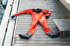 The diving suit on a pier Stock Photo