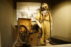 Diving suit from  1940s. ASTORIA, OREGON - OCT 1, 2015 - Diving suit from the 1940s,  Columbia River Maritime Museum Royalty Free Stock Photos