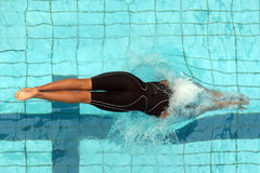 Diving swimmer 003. A swimmer enters the water with a dive at the start of a race Royalty Free Stock Image