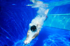 Diving into a swimming pool. An energetic dive into a swimming pool Royalty Free Stock Photos