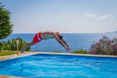 Diving in the swimming pool royalty free stock photos