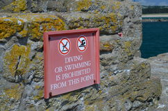 Diving or swimming prohibited sign. Stock Photos