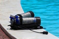 Diving tanks. A pair of diving tanks at pool Stock Images