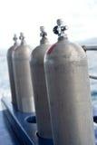 Diving tanks. Compressed air tanks preparing for diving trip royalty free stock photography