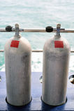Diving tanks. Compressed air tanks preparing for diving trip royalty free stock images