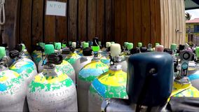 Diving tanks, oxigen tanks. closeup. Diving tanks, oxigen tanks. Cylinders with compressed air for diving stock footage
