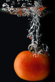 Diving tomato Stock Image