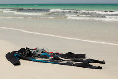 Diving uniform on the beach. Diving uniforms on the beach with aqualung Stock Images