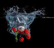 Diving vegetable. Pot with vegetables falls into the water Royalty Free Stock Photos