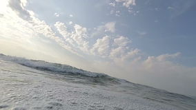Diving into waves stock video footage