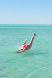 Diving young woman tropical sea legs up Royalty Free Stock Photography
