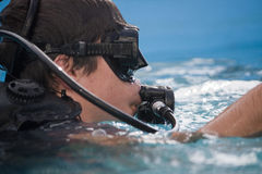 Divint suit. View of male on a diving suit on a pool Stock Images