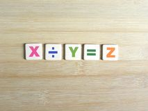 Division in algebra. Division concept in algebra X/Y=Z on wood background stock photo