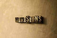 DIVISIONS - close-up of grungy vintage typeset word on metal backdrop. Royalty free stock illustration. Can be used for online banner ads and direct mail stock photo