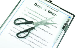 Divorce. Decree and symbolic scissors isolated against white Royalty Free Stock Photo