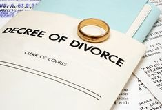 Divorce. Decree and wedding ring symbolizing the end of a marriage Stock Photo