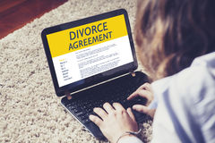 Divorce Agreement concept: Laptop computer with Divorce Agreement in the screen. Royalty Free Stock Photos
