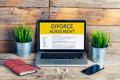 Divorce Agreement concept. Laptop computer with Divorce Agreement in the screen Stock Image