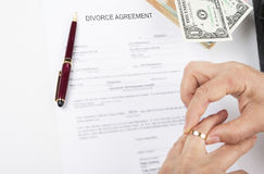 Divorce agreement. Woman taking out wedding ring after the divorce stock photos