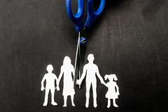 Divorce and child custody scissors cutting family apart.  Royalty Free Stock Images