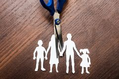 Divorce and child custody scissors cutting family apart.  Royalty Free Stock Photography