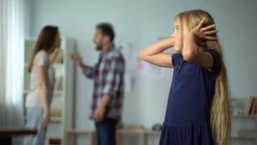 Divorce and children, unhappy little girl suffering quarrels between parents