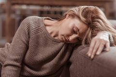 Close up of woman feeling awful after divorce with husband. After divorce. Close up of mature blonde-haired woman feeling awful after divorce with husband royalty free stock photography