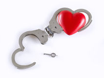 Divorce. Concept of divorce adapted to handcuffs. One of them is open and free, on white background Royalty Free Stock Photo