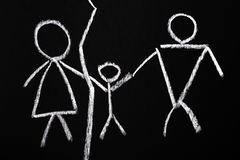Divorce concept. Chalk drawing of a family divided by a line.  stock photography