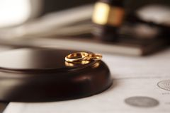 Divorce concept. Close up of wedding rings stock photos