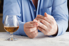 Divorce concept. man taking off wedding ring Royalty Free Stock Photography