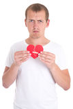 Divorce concept - sad man holding broken heart with plaster Stock Photography