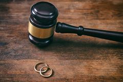 Wedding rings and judge gavel on wooden background, copy space royalty free stock images