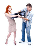 Divorce,  couple fighting about big black box Royalty Free Stock Image