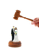 Divorce court. Wedding couple figures and court gavel, on white Royalty Free Stock Photos