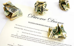 Divorce decree. Document and crumpled up money Stock Photo
