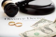 Divorce decree, gavel and wedding rings. stock photography