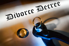 Divorce Decree and Pliers Cutting a Wedding Ring Royalty Free Stock Images