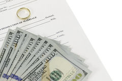 Divorce Form With Fan Of Hundred Dollars Bills. Form laying on diagonal on a white background. Also a gold wedding ring on form Stock Image