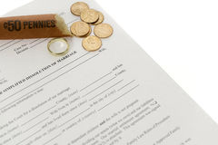 Divorce Form With Open Roll of Pennies. Done on diagonal on white background Royalty Free Stock Photo
