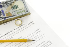 Divorce Form With Stack Of Hundred Dollars Bills And A Pencil. Laying on diagonal on white background Royalty Free Stock Photography
