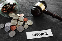 Divorce message with coins and gavel Royalty Free Stock Image