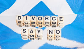 Divorce: say no !. Scottish flag Saltire, with text in black upper case letters on small white cubes saying  Divorce say no  relating to the referendum to be Stock Photos