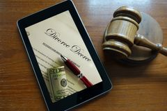 Divorce screen. Divorce Decree document on a tablet screen Stock Photography