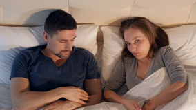 Divorce and separation concept. A couple in bed having problems and crisis. stock video footage